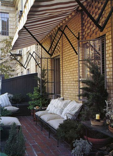 Brick patio/terrace; Thomas O'Brien furniture