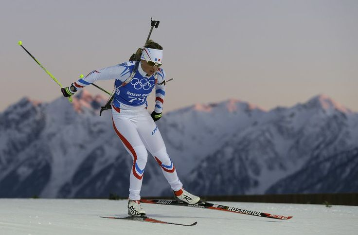 Marie Dorin-Habert of France skis past mountain tops during a Biathlon training session at the 2014 Winter Olympics