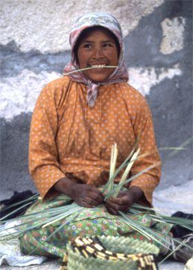A Young Tarahumara Lady Weaves a Basket
