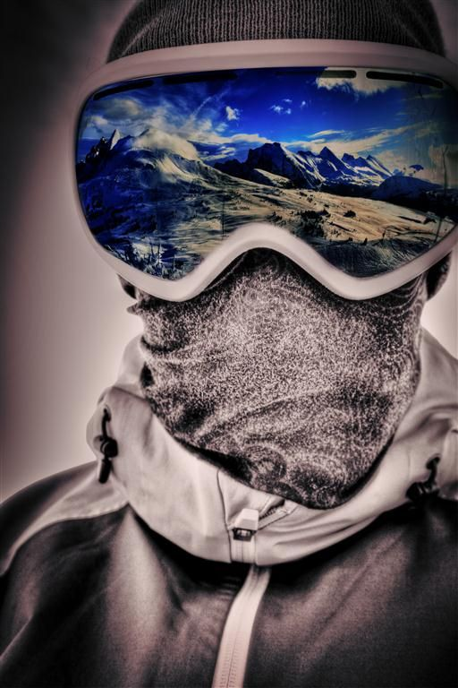 Great photo of mountain skiing.  Black and white with blue iridium / polarized reflective googles.