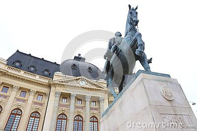 Statue Carol I of Romania on horseback and Central University Library in background.