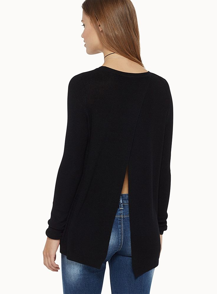 Exclusively from Twik     Back detailing is in! We love the pointed opening for a bold and feminine touch   Ultra stretch, thin ribbed knit   Loose fit with drop shoulders for a very trendy relaxed look    The model is wearing size small