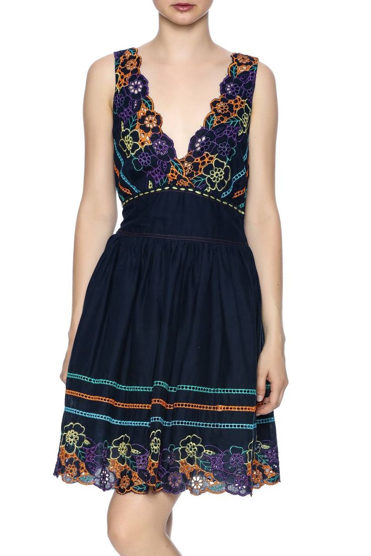 Blue fit and flare dress with colorful floral embroidery, v-neckline and an elastic waistline.    Blue Yellow Dress by Nick & Mo. Clothing - Dresses - Casual Wyoming