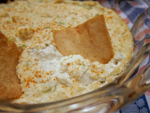 Hot Crab Dip  I added a can of artichokes and extra hot sauce it was good! I used GOOD lump crabmeat, made all the difference!  2 pkg or 2 cans crabmeat  1 lb cream cheese, softened  1/2 cup mayonnaise  1 bunch green onions, chopped  2 dashes red hot sauce  2 tsp worcestershire sauce