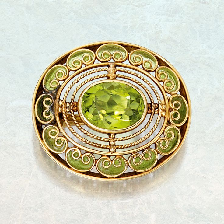 Gold, peridot and plique-à-jour enamel brooch, Tiffany & Co., Designed by Louis Comfort Tiffany, circa 1910.