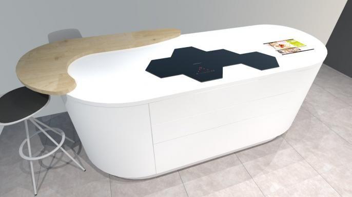 Zoom sur l'îlot d'une cuisine futuriste à découvrir absolument avec:   -Plaque induction hexagonale  -Meubles arrondis -Ouverture électrique  -Ecran tactile intégré dans le plan de travail en Corian - ...  http://www.cuisines-hugo-martin.fr/cuisiniste-rouen/cuisine-prix-salon-meuble-mobilier-3d-cuisiniste-barentin-paris/cuisine-futuriste-blanche-avec-ilot.html