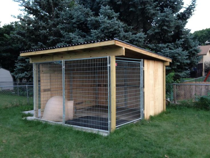 Kami's finished kennel.  Roofing material, wood, nails, privacy fence, and screws...  My fabulous husband and my father-in-law put the roof together, and my husband and I put the privacy fence together...  Lots of work, but my little dude LOVES his outside space.  Fencing is great to provide shade in the evenings and keep the kennel cool...  Also keeps the little dude from getting all worked up about the neighbor dogs...