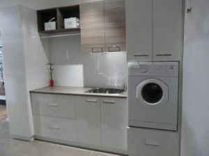European style laundry. I want storage for my laundry hampers, my brooms, vacuum & cleaning supplies and my laundry supplies as well as hiding my washing machine & dryer.