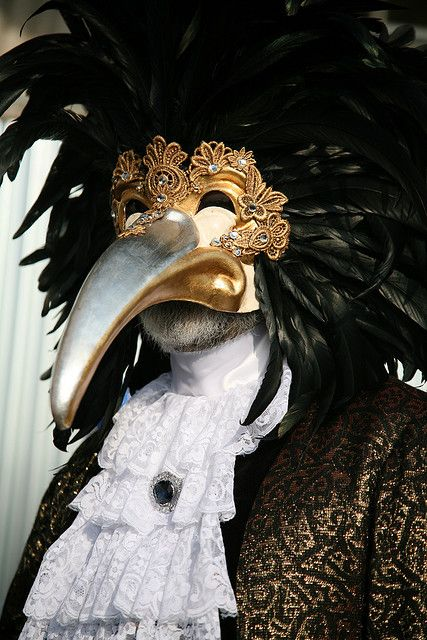 Uccellaccio, paper mache mask decorated in gold and silver lives and embellisshed with lace macramè and Swarovski crystals