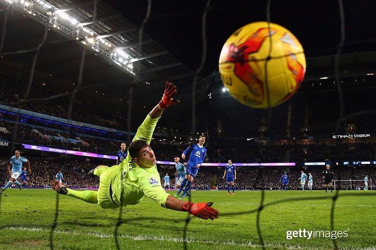 All that Everton goalkeeper Joel Robles can do is watch as #ManchesterCity's Sergio Aguero scores the winning goal in the #CapitalOneCup Semi Final second leg match at the Etihad Stadium in #Manchester #England | January 27 2016 | : Alex Livesey | #GettySport #MCFC #ManCity #football by gettyimages