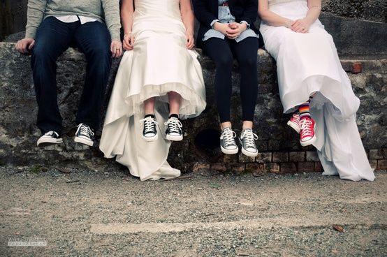 converse with bow ties   The grooms go with bow tie, suspenders or vest...