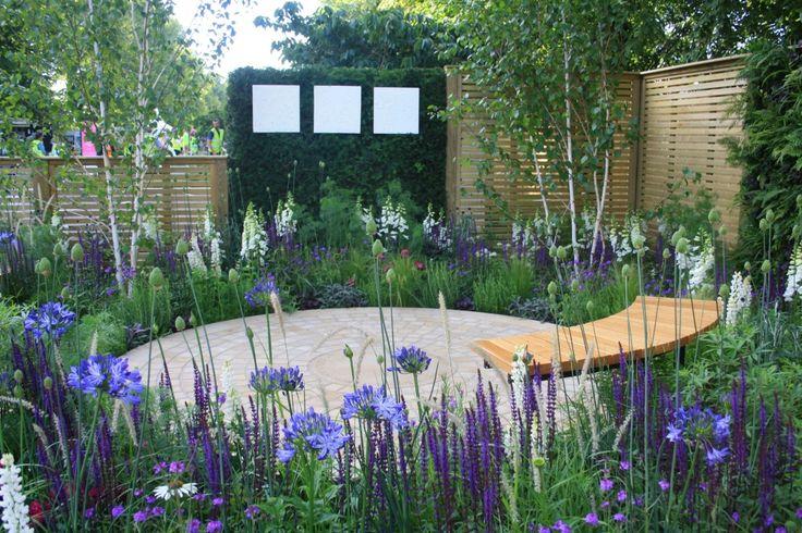 the wellbeing for women garden, green wall, flowers, curved garden bench