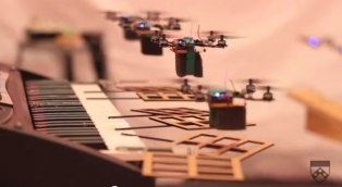 _  LONG BEACH, Calif. -- The machines have won – at least when it comes to being able to play music better than a Mashable editor.      While that might not be saying much in my case, the music video that debuted at the TED conference on Wednesday showing flying, autonomous robots playing ...