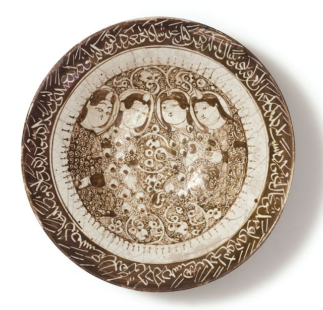 The four figures in this dish exemplify the 12th-century Seljuk-Persian aesthetic of 'moon-faced' beauty. Iran, Kashan. Early 13th century. Other/unnamed script. Courtesy of the Courtesy of the Nasser D Khalili Collection of Islamic Art.
