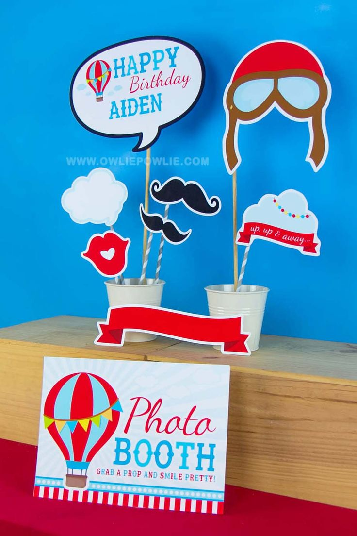 every party need photo booth props! add up more FUN in your party with mustache & birthday wishes with this photo booth props for the red & blue Vintage Hot air ballon kids birthday party dessert table at www.owliepowlie.com