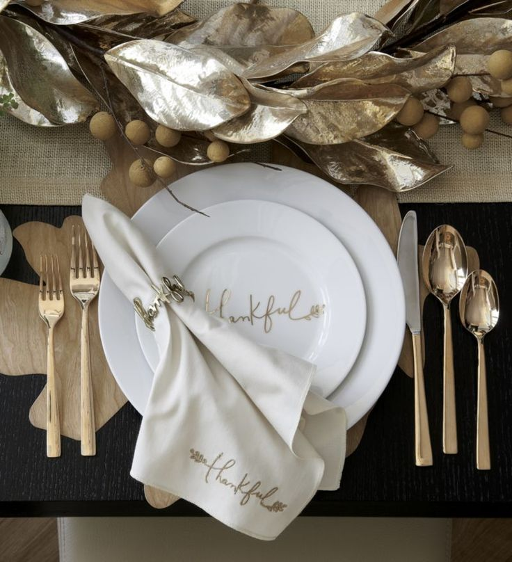 """A graceful message of """"Thankful"""" gratitude by artist Kelly Ventura gilds this versatile Thanksgiving accent plate in gleaming gold metallic handwriting with a botanical flourish. Broad-rimmed white porcelain plate coordinates with the Thankful platter and place cards, sold separately."""
