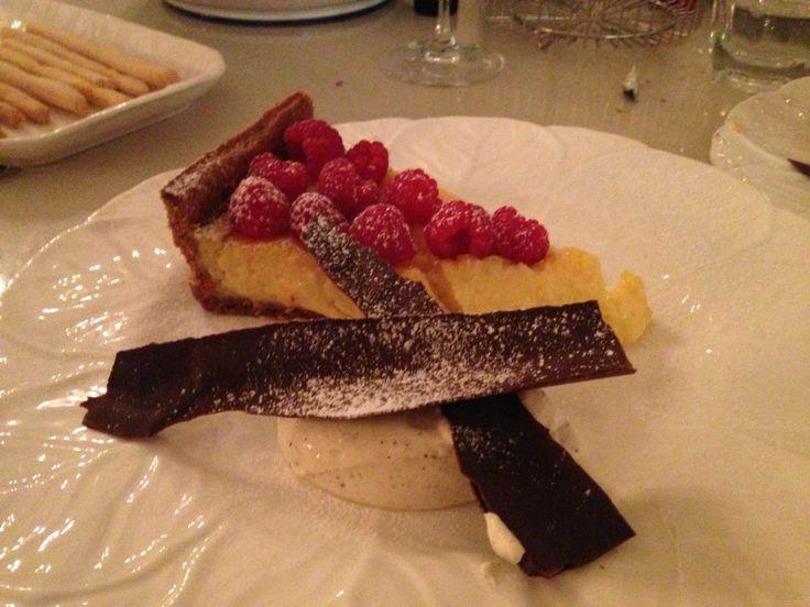 Limoncello tart with raspberries, cardamom cream and dark chocolate peppermint bark. #tarts #limoncello #desserts #baking #homecooking #chocolate