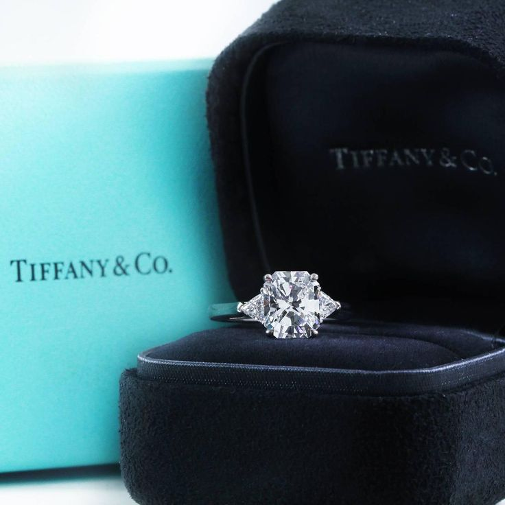 Tiffany & Co. 2.73 Carat Radiant Cut Diamond Gold 3 Stone Engagement Ring  | From a unique collection of vintage engagement rings at https://www.1stdibs.com/jewelry/rings/engagement-rings/