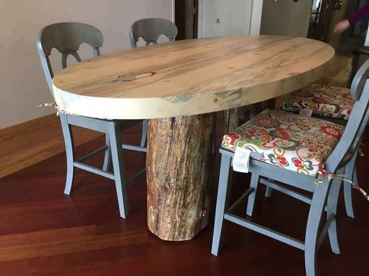 Beetle kill pine round table with stump legs. This is our