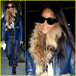 Rihanna bundles up in a leather jacket with a fur collar while heading into JFK Airport for an outbound flight on Thursday evening (January 30) in New York