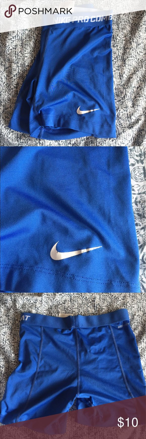 "Nike cobalt blue spandex Good condition. Some crackling on the Nike logo. Not the 2.5"" spandex. They are like 4-5"" Nike Shorts"