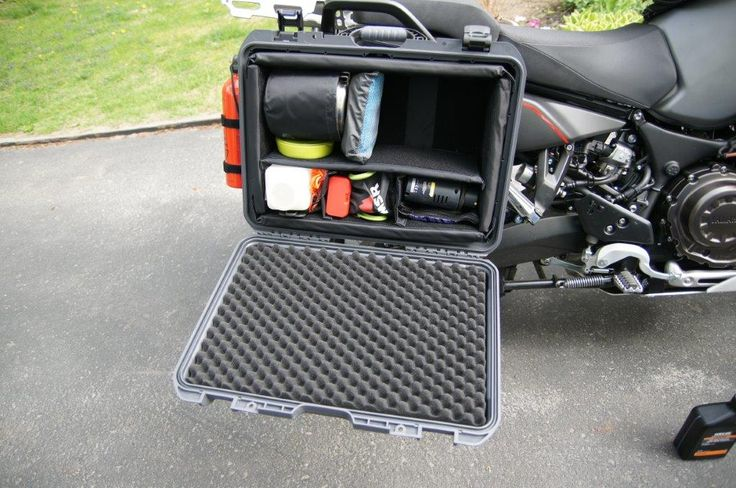 Yamaha Super Tenere 2014 ES equipped with Nanuk 940 in Graphite color. The opened case shows the padded dividers setup to protect the interior equipment. The client also added a small holding net later on to keep the content from rolling out of the case.