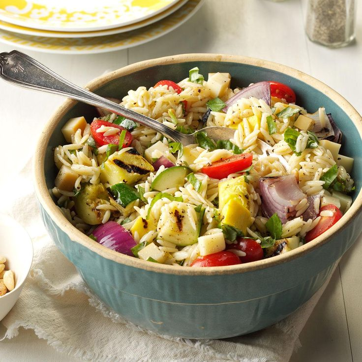 Farmer's Market Orzo Salad Recipe -Orzo is a tiny pasta shaped like rice. We like to use it as a base for veggies, lemony vinaigrette and cheeses like mozzarella, feta or smoked Gouda. —Heather Dezzutto, Raleigh, NC