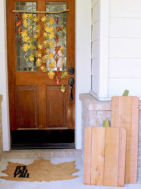 Flaunt your creativity this year by crafting your front door pumpkin display from wood fence pickets.
