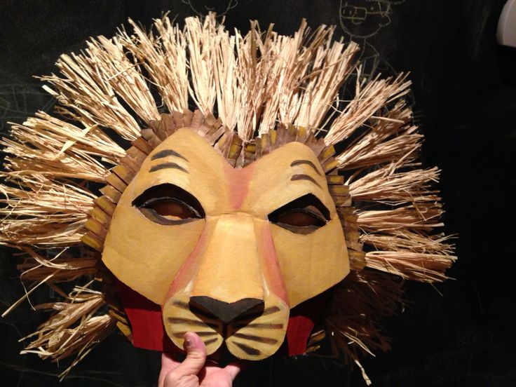 Simba mask:  cardboard, paint, raffia                                                                                                                                                                                 More