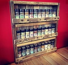 Looks simple enough to make... I like the way the wood is in the back of this one.   Rustic Pallet Spice Rack