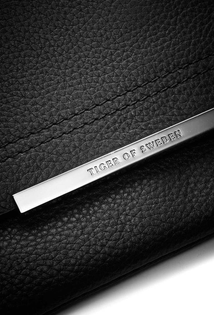 Brare bag-Women's clutch bag in medium grained leather. Embossed Tiger of Sweden logo on front plate. Detachable shoulder strap. Inside zip pocket. Magnetic closure. Cotton lining. Size: 30 x 15 cm.