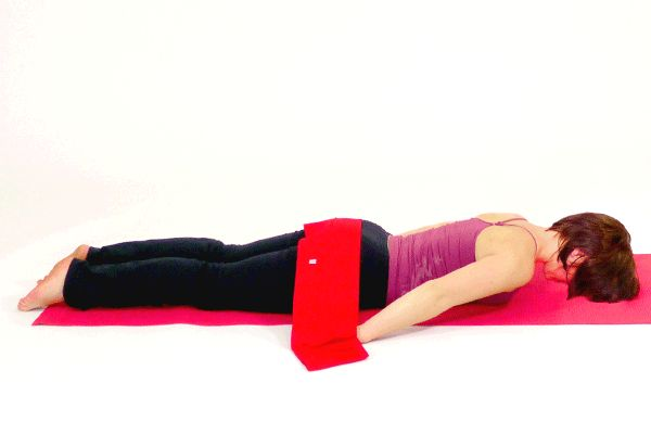 Description:  This is an advanced exercise for strengthening the back and glute muscles. -- Instructions:  1. Lie face down on an exercise mat or on the floor. Your hands should be in the pockets of the Pilates band and the Pilates band should be over your buttocks. -- 2.  Exhale and lift your legs and upper body off of the floor while lifting your arms up toward the ceiling.   Hold this position for 2-3 seconds, then inhale and slowly lower yourself back to the  floor. Repeat 3-5 times.