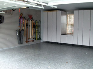 Custom Gray Cabinets Surround The Window And Gray Storewall Panels Line The Walls Creating Tons Of Storage By Garage Desi Garage Design Grey Cabinets Design