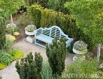 French-Inspired Garden in the Pacific Northwest | Traditional Home. This bench and pots idea would look good on the lower level of our back garden that backs up to Mike and Jamie.