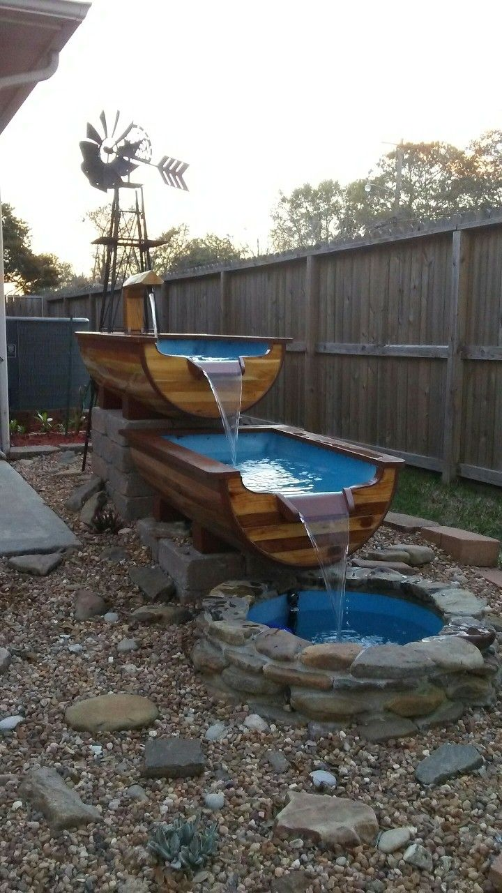 Water Sluice Made With Plastic Barrels And Fence Board In