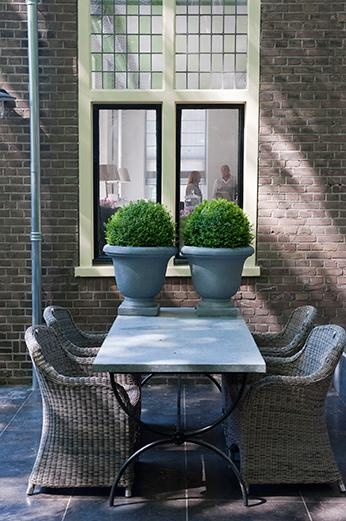 symmetry - beautiful blue gray table with blue gray urns and trimmed boxwood in the urns - charming