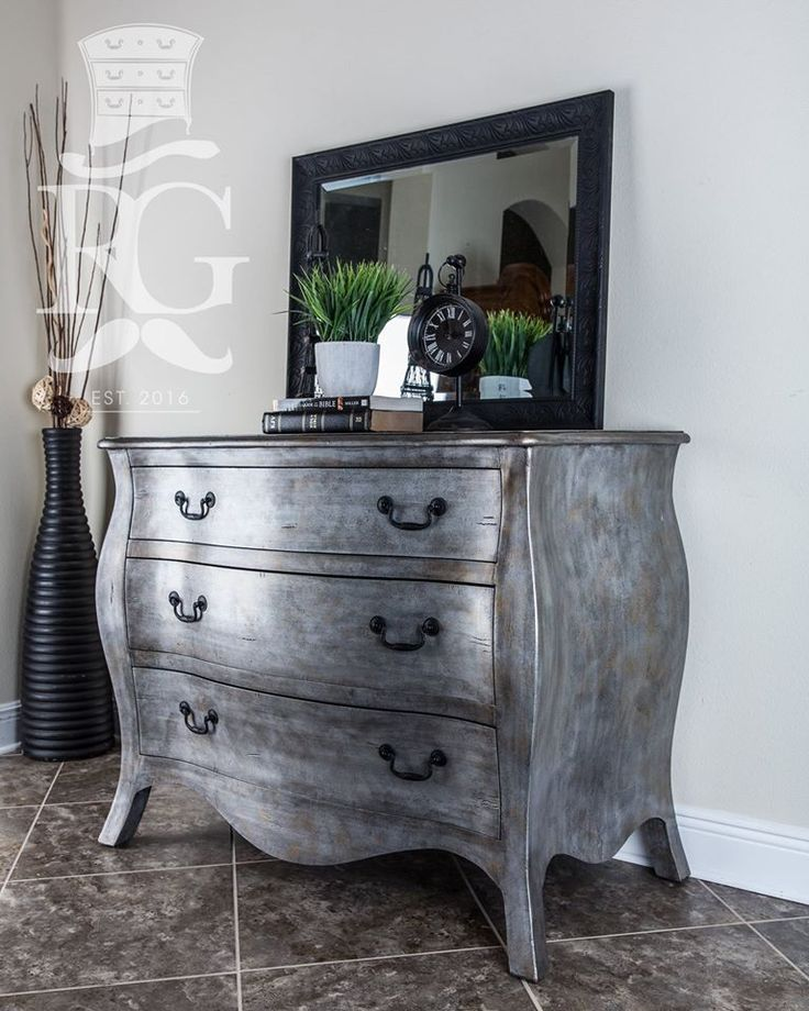 """""""Very excited to finally post this piece and my new specialty finish I'm calling 'Knights Armor.' This Large Bombay Chest updates any bedroom or entry way with an elegant and classically aged style. """"Hand-painted using General Finishes Queenstown Gray Milk Paint as a base coat, with a secondary coat of Argentine Pearl, Pearl Effects; painted on and textured to give this unique look. Then layers of Bronze & Tawny Pearl Effects, applied to add to the depth."""