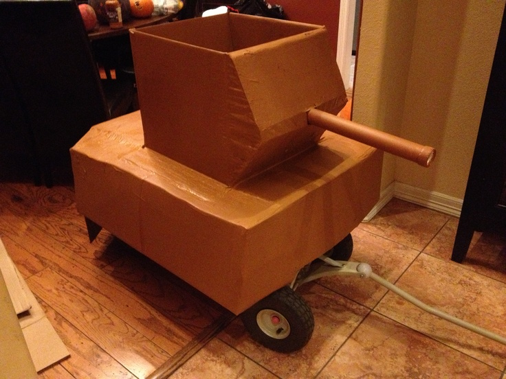 Turned our daughters pink John Deere wagon into a Army Wagon for my sons Halloween costume.
