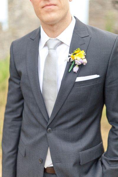 dark grey suit and light grey tie for groom. groomsmen have light grey suits/vests and yellow ties. Best man has dark grey as well?