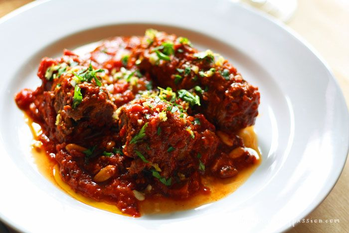 Braciole is a festive, special occasion dish. There are versions from Sicily and southern mainland Italy. Tiny packages of beef stuffed with cheese, pine nuts, and raisins, simmered in red gravy.