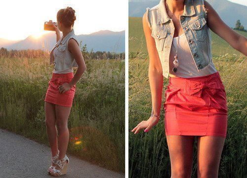 Cropped jean vest over white tank and bright skirt. Add the studded brown belt.