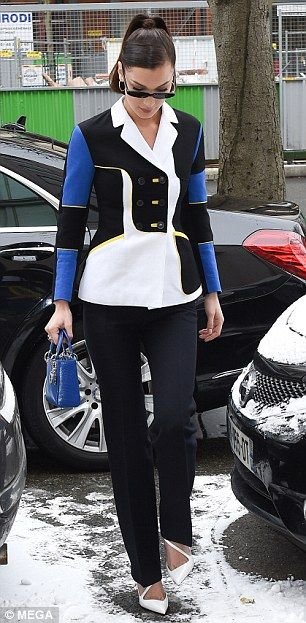 All in the details: Bella, sister of fellow model Gigi Hadid, complemented her ensemble with a cobalt blue handbag, while she opted to shield her eyes behind a pair of thin sunglasses