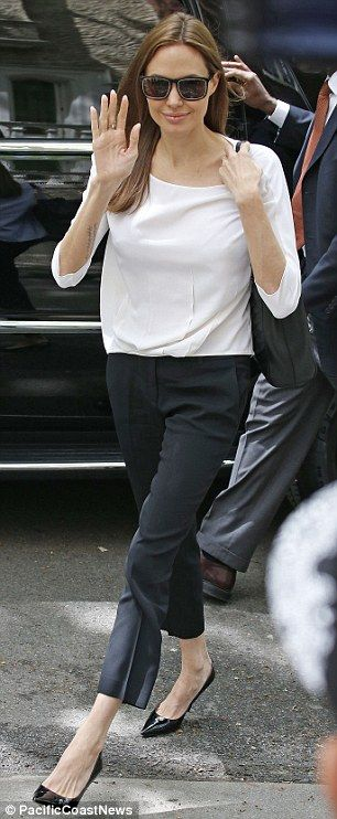 Effortlessly chic: The star looked slender as ever in her classic, conservative outfit of black Capri dress pants, a plain white three-quarter-sleeve blouse and pointy black patent leather heels