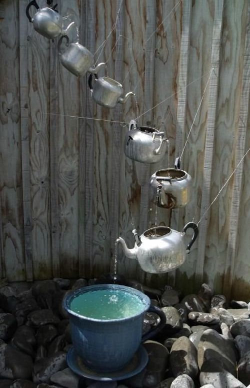 "Tea pot ""fountain"". Kinda like a rain chain."
