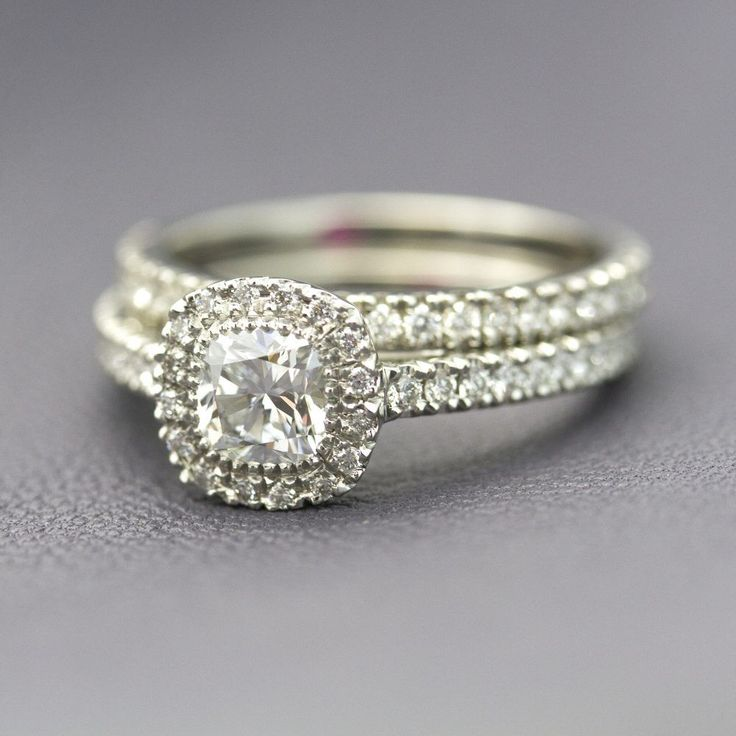 #cushion cut diamond halo engagement ring with matching diamond pave wedding band