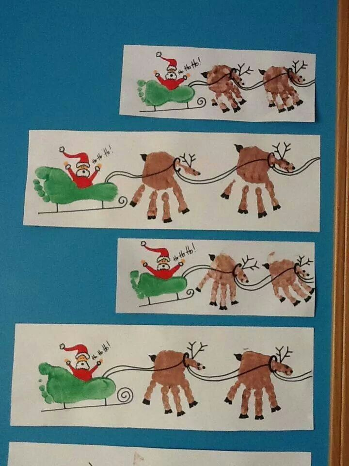 Christmas Santa and sleigh using hand prints.