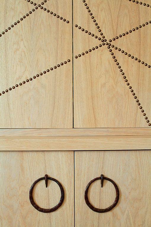 Limed oak doors, bronze nailing, 'Ring' handles.