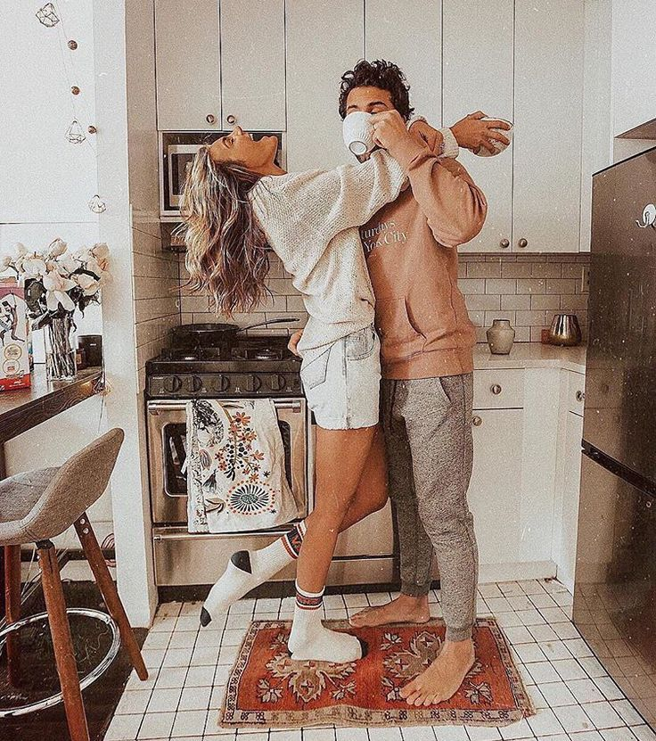Cute couple photography inspiration. Coffee in the kitchen at home. Engagement photoshoot posing poses inspiration ideas.