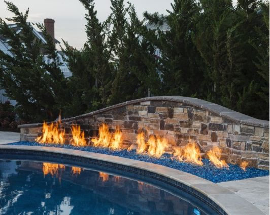 1000 images about pools on pinterest natural stones pool designs and swimming pools for Fire features for swimming pools