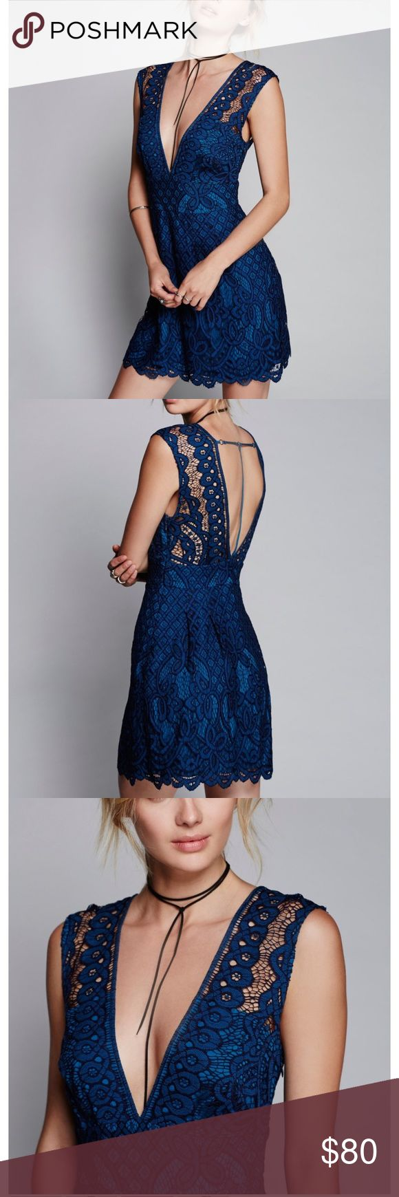 Free people one million lovers dress Lovely lacey dress featuring a front and back plunging V with a cute back strappy detail. Femme fit-and-flare shape. Hidden side zipper closure. Lined. 60% Cotton. 40% Nylon. Hand Wash Cold. Color: blue Free People Dresses Mini